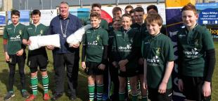Picture are Under 14 members of Hayle RFC handing two Goal Nets to Graham Coad. These will shortly be fitted to the Goalposts in Hayle Park